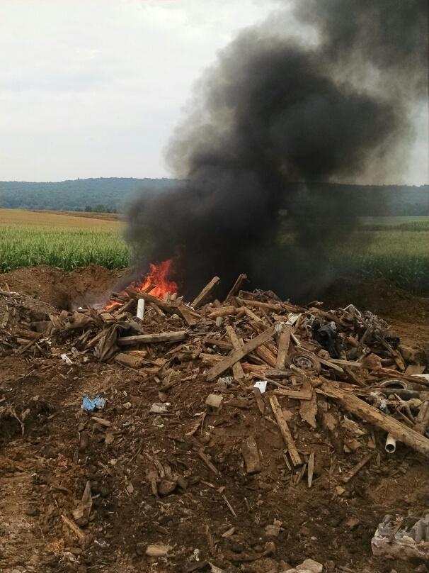burning old barn debris at farm
