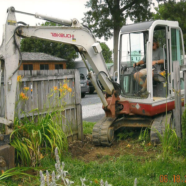 Mini – Excavator with thumb attachment: minimal damage to property and the availability to work in tight spaces.